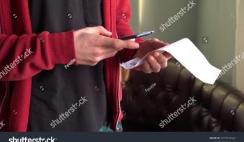 stock-photo-a-man-scans-the-qr-code-on-a-check-from-a-supermarket-1277572462