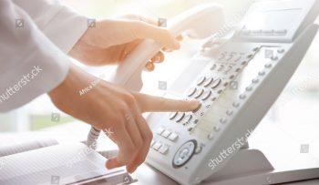 stock-photo-businesswoman-with-office-ip-telephone-476542468