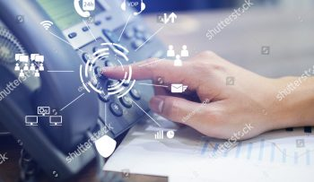 stock-photo-close-up-employee-call-center-man-hand-point-to-press-button-number-on-telephone-office-desk-with-1142418437