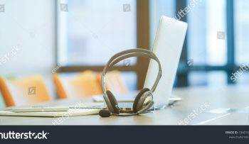 stock-photo-close-up-soft-focus-headphone-call-centre-hotline-at-computer-office-help-desk-for-background-1040167465