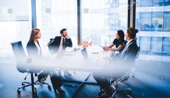 stock-photo-concept-of-brainstorming-and-briefing-positive-diverse-male-and-female-financial-experts-1389400187