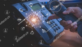stock-photo-hand-of-man-using-ip-phone-with-flying-icon-of-voip-services-and-people-connection-voip-and-1021468648