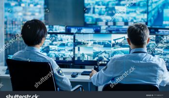 stock-photo-in-the-security-control-room-two-officers-monitoring-multiple-screens-for-suspicious-activities-771480577