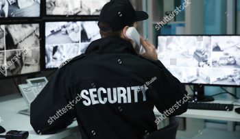 stock-photo-male-security-guard-talking-by-telephone-in-surveillance-room-1008332989