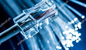 stock-photo-network-cable-and-optical-fibers-with-lights-in-the-ends-blue-background-1074113240