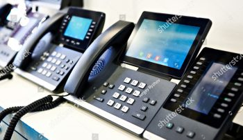 stock-photo-office-phones-at-the-exhibition-1477829063
