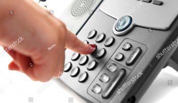 stock-photo-woman-hand-is-dialing-a-phone-number-with-picked-up-headset-146346692